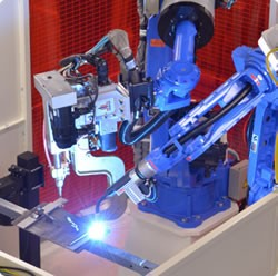 In electrically noisy vision-based robotics applications, a computer may need to be located at some distance from a camera to eliminate any interference issues Image courtesy Yaskawa Motoman Robotics